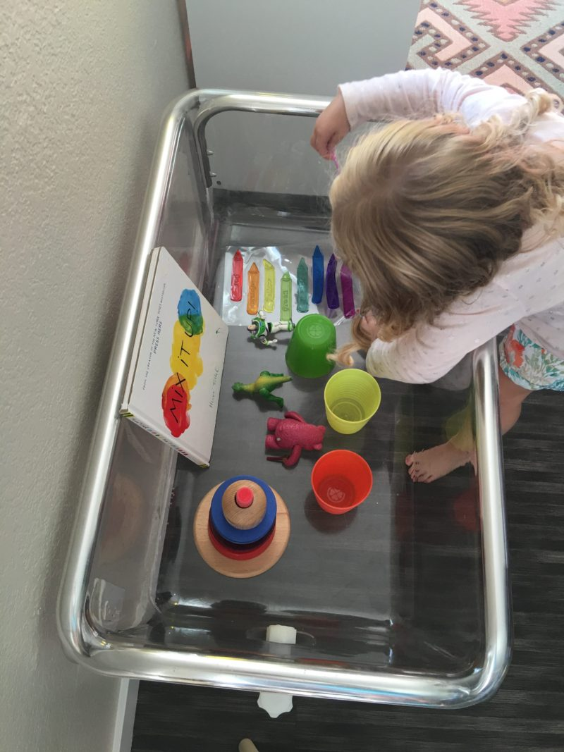 Colorful play today in this sensory bin filled with bright colored objects.