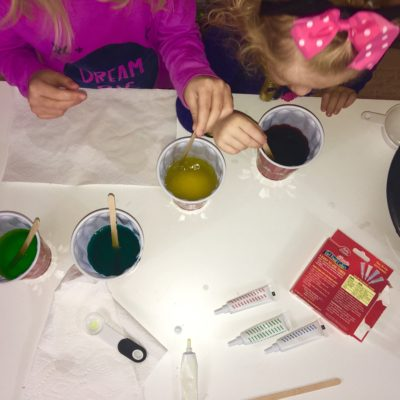 Making Rainbow slime.  Allowing the kids to be part of the process helps to grow their listening skills, sharing and confidence.  Check out the website for additional steps.  How2play.today