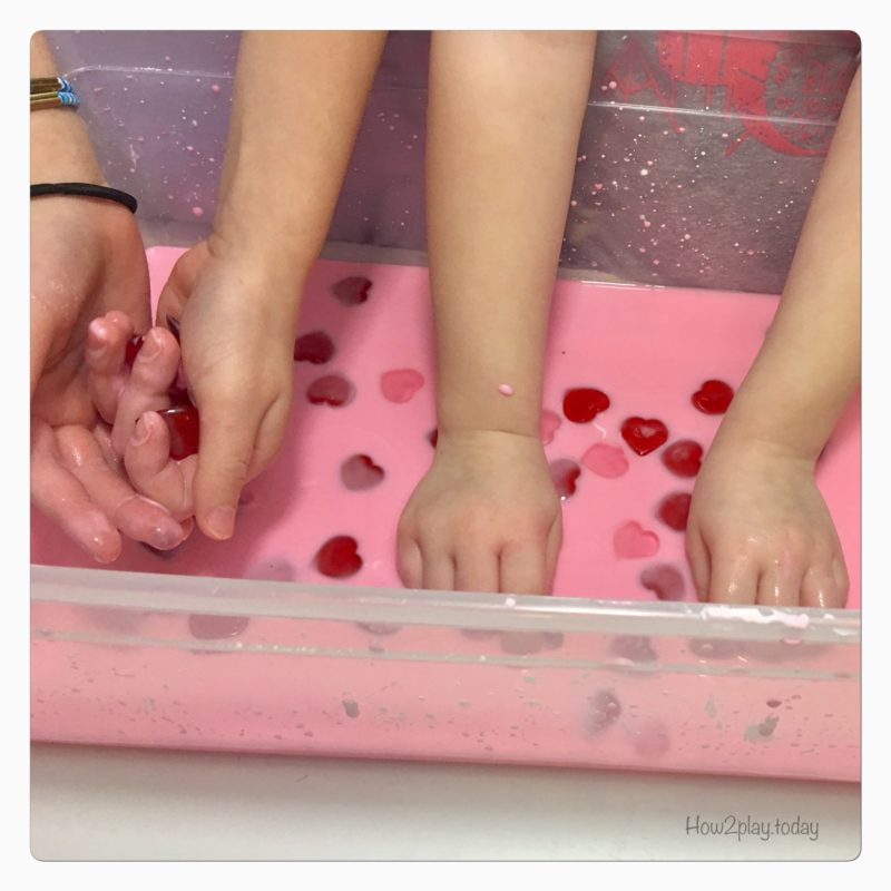 Valentine's Goop Sensory play. This goop or oobleck is super simple to make with water and cornstarch. Add some food coloring and little toys of your choice and you have a great invitation to play for sensory/ science time.