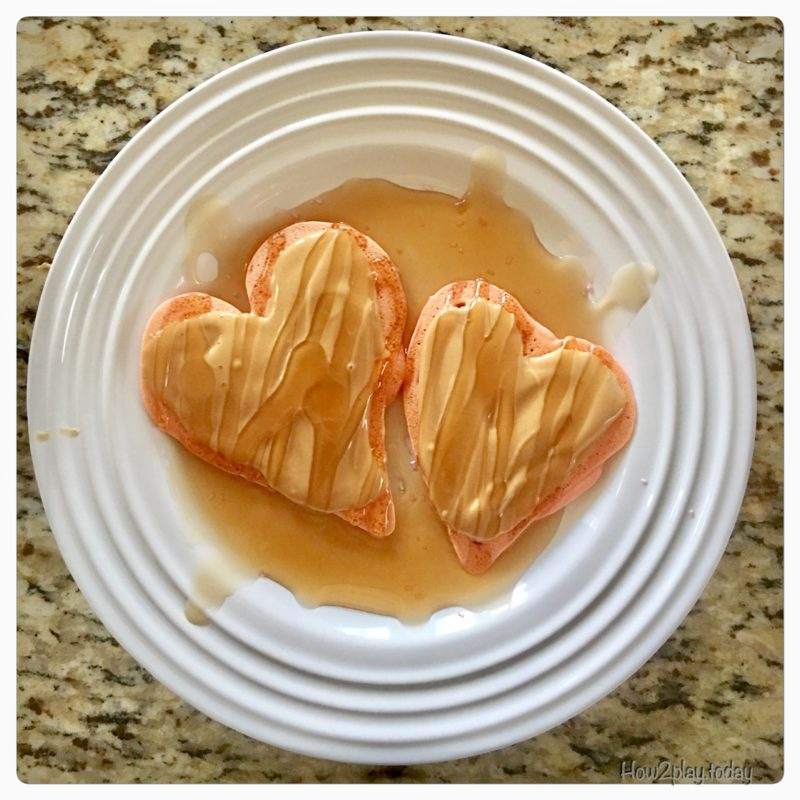 Valentine snacks are easy to make and add some fun to your loved ones. A little food coloring and a squeeze bottles makes your morning pancakes into a sweet dish.