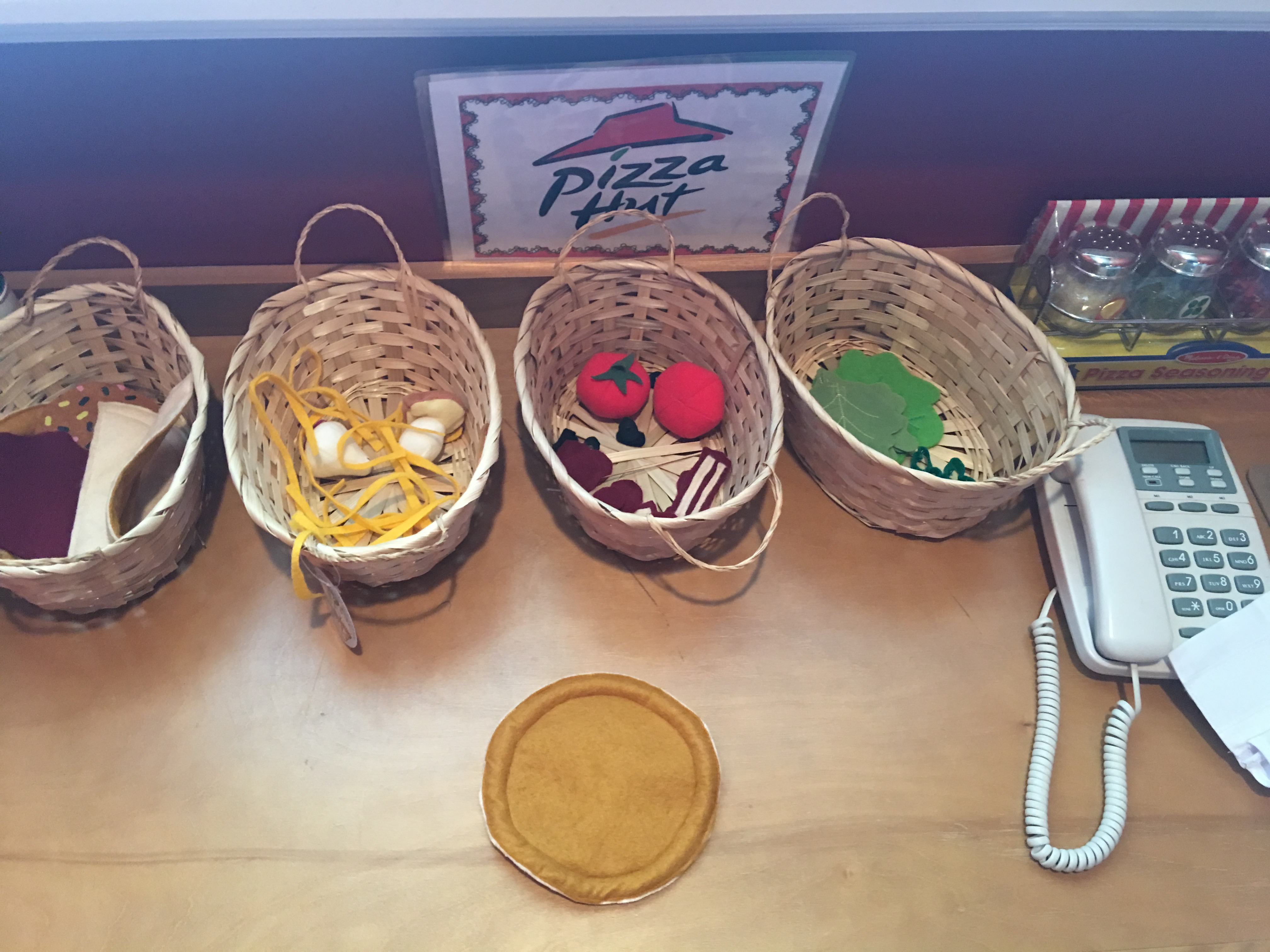 Pizza Dramatic Play: It's great to get the kids involved in cooking for real in the kitchen but replicating some of the food items for dramatic play, allows them to continue to act out what they're learning in a safe and fun environment