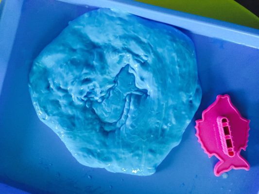 Homemade ocean slime is great for sensory play. @how2playtoday