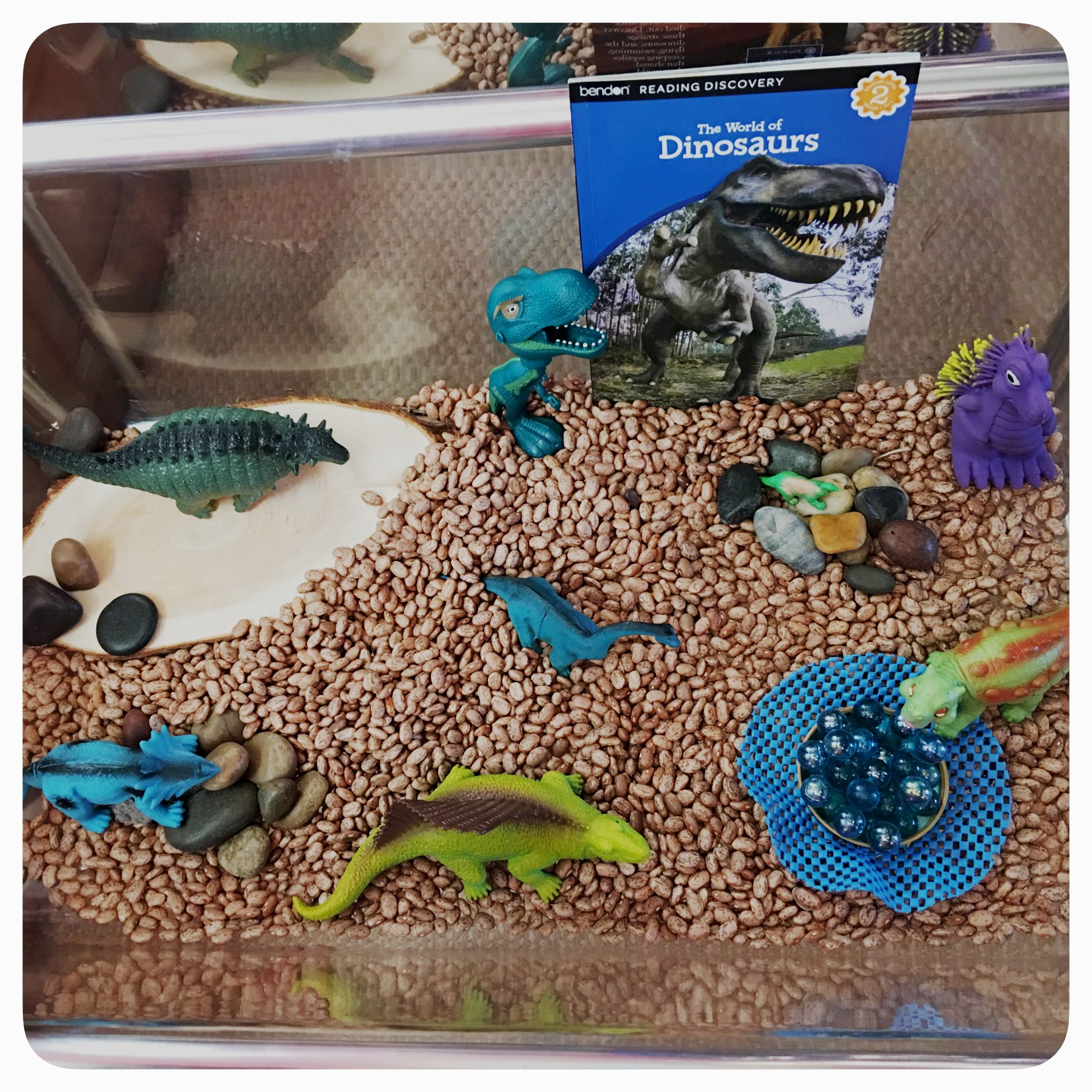 Creating simple sensory bins for exploring Dinosaurs by @How2playtoday