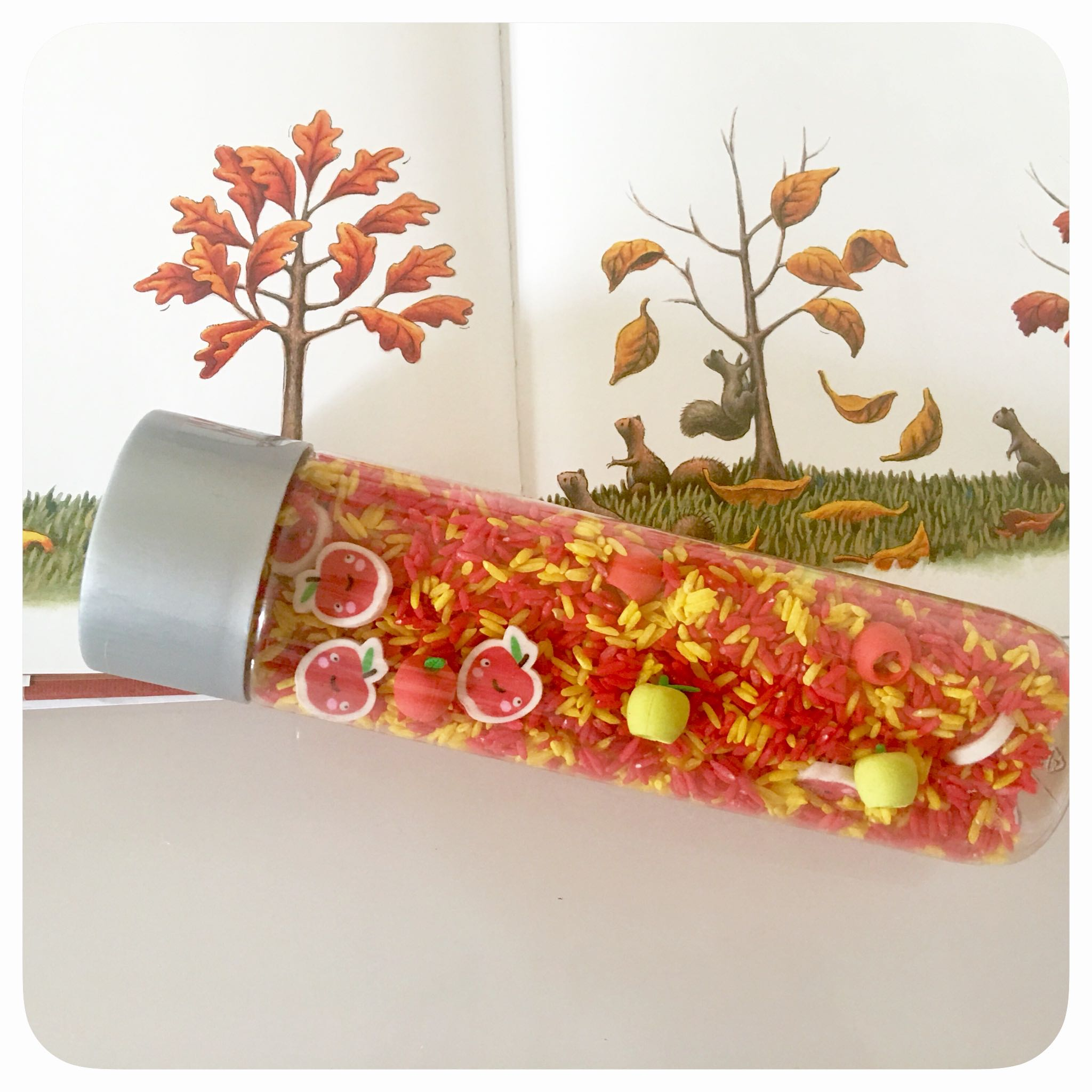 Apple Sensory Bottle: Creating simple sensory bottle activities to explore the letter A and apples. This enhances your child's fine motor skills as they help you to create this wonderful autumn-inspired sensory bottle.