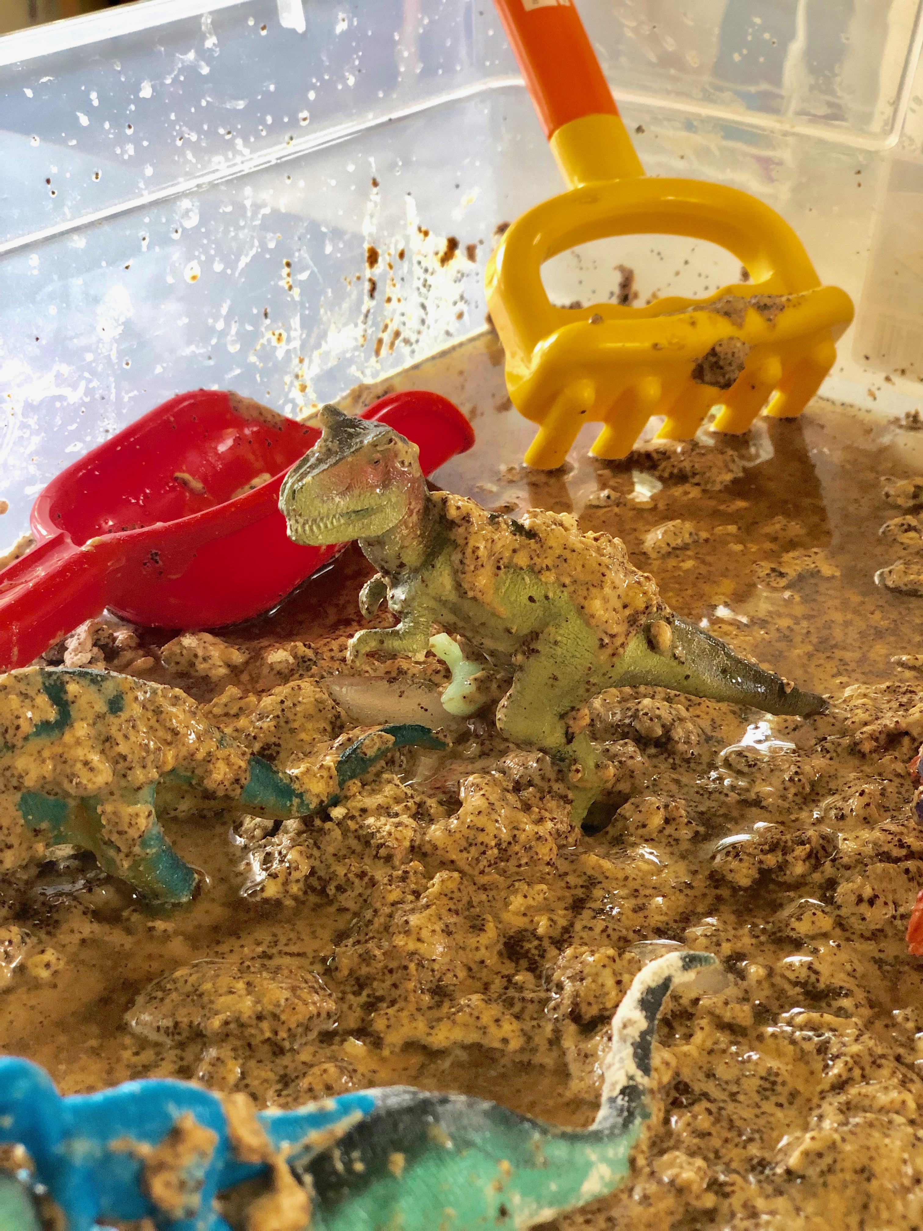 "🦕 Dirty Dinosaurs 🦖 Flour, water, and coffee grounds = this fabulous smelling ""mud"" to have our dinosaurs play in. Then time to clean them off 🧼 Sensory bin using food 💫 I've been creating these types of bins for almost 20 years. This is a fun & Simple way you can play today with your child."