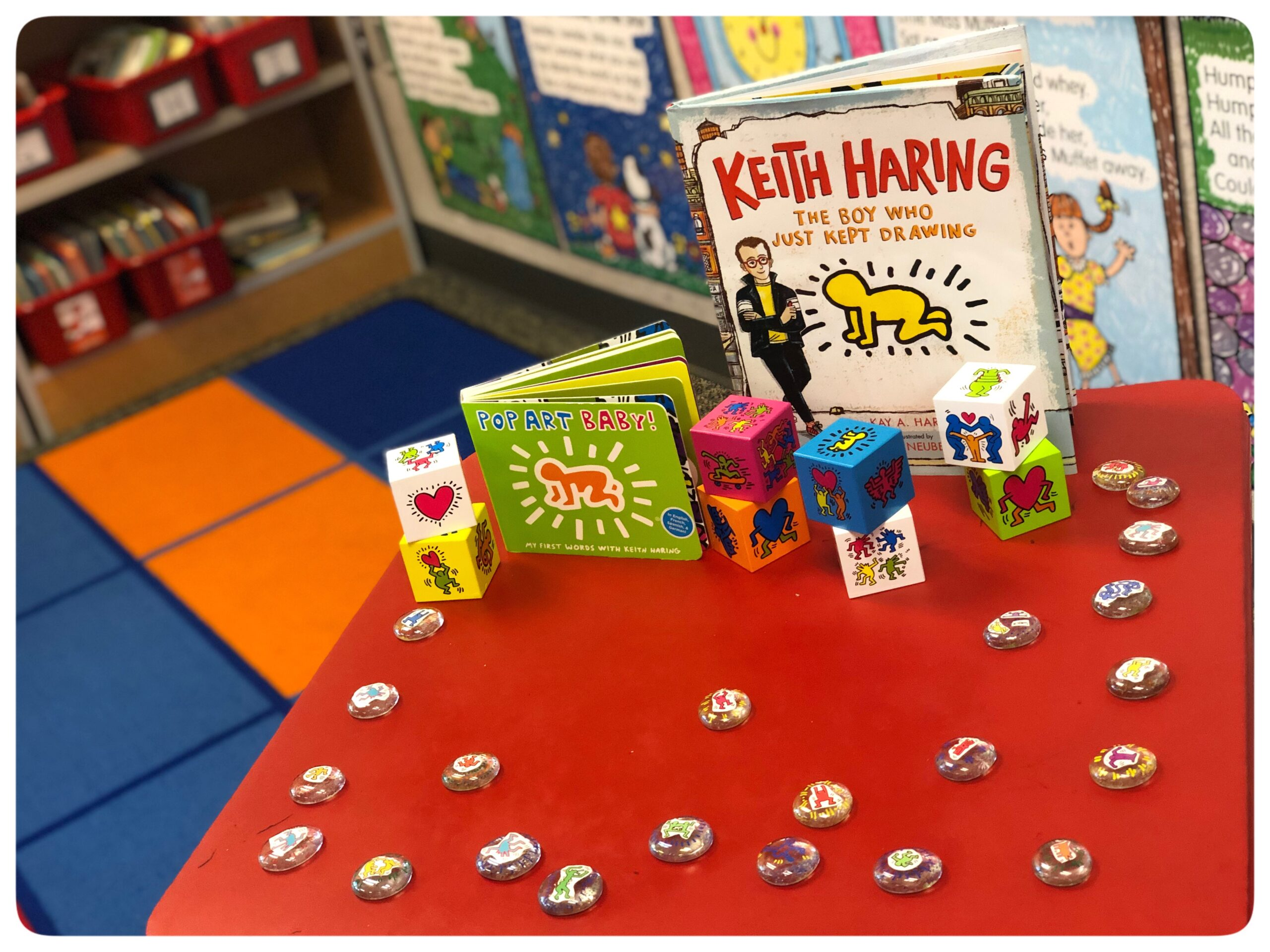 Sensory Table: Keith Haring, a famous artist, is primarily known for solid, bold lines with vibrant colors.  His vibrant artwork tells of friendship, fun, and acceptance. Today we're creating interactive ways to think about Pop Art while learning about Keith Haring