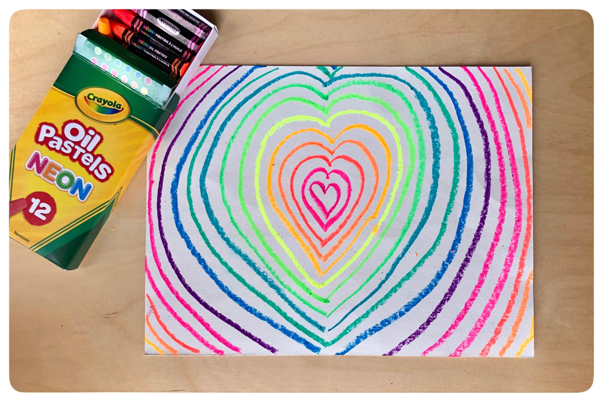 Keith Haring, a famous artist, is primarily known for solid, bold lines with vibrant colors.  His vibrant artwork tells of friendship, fun, and acceptance. Today we're creating interactive ways to think about Pop Art while learning about Keith Haring.  Come create these concentric hearts with a special surprise at the end to add a little POP to your creation. 💗